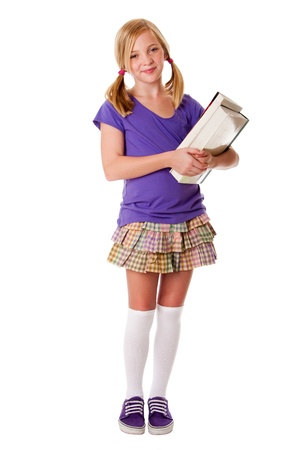 Girl School: Beautiful happy teenager school girl carrying books, standing and smiling, isolated.