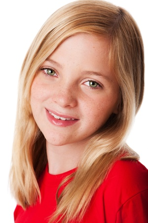 freckles: Beautiful face of a happy smiling teenager child girl with green eyes and blond hair, isolated. Stock Photo