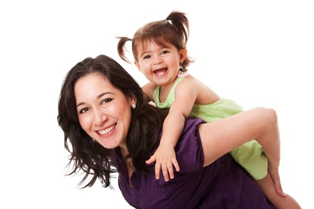 Happy laughing toddler girl playing with mom doing a fun piggyback ride, isolated.