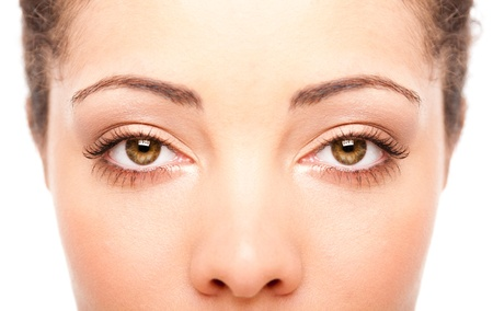 health fair: Beautiful female eyes as windows to the soul on face with fair skin, health concept, isolated.