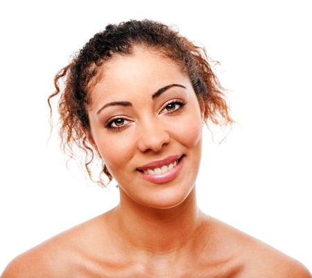 Female face with beautiful smile and clean clear skin with messy hair, skincare concept, isolated. Stock Photo - 10129484