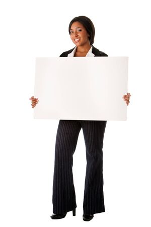 pitching: Beautiful smiling successful corporate business woman pitching an idea presenting blank whiteboard advertisement, isolated.