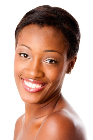 Beautiful face of a happy attractive African young woman smiling with healthy pimple acne free skin and white teeth, skincare or dental care concept, isolated. Reklamní fotografie