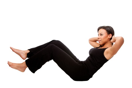 crunch: Young happy beautiful woman during fitness time exercising for health  staying in shape doing crunches situps, in black, isolated.
