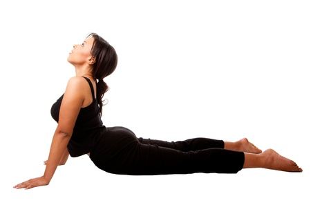 Beautiful attractive woman stretching exercise workout Cobra Yoga position, dressed in black, isolated. Фото со стока