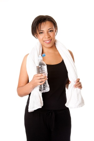 thirst quenching: Beautiful attractive happy young sweaty woman with water after exercise workout, rehydrating thirst quenching, isolated. Stock Photo