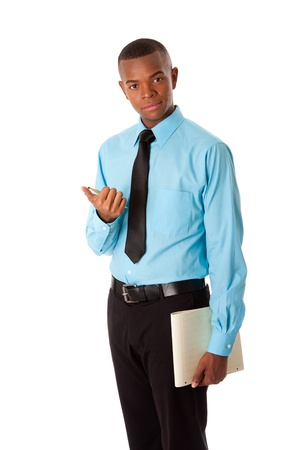 Handsome happy young male corporate MBA business student in blue shirt and black tie clicking pen holding notepad, isolated.