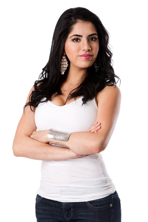 Beautiful confident self-secure attractive young woman standing with arms crosses wearing white shirt, isolated. Stock Photo