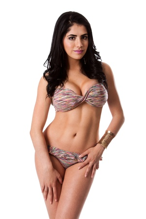 hot bikini: Beautiful happy young brunette woman in sexy colorful bikini standing, isolated. Stock Photo
