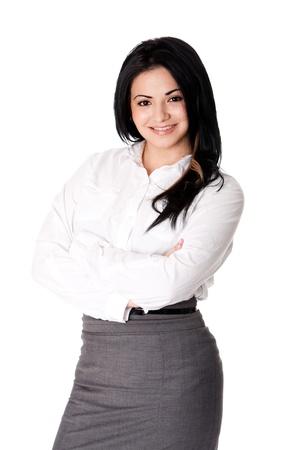 Mooie gelukkig lachende jonge vrouw corporate business MBA-student staan met de armen gekruist het dragen van witte blouse amd grijze jurk rok, geïsoleerd.
