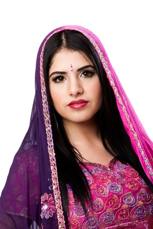 Face of beautiful Bengali Indian Hindu woman in colorful dress and veil, isolated photo