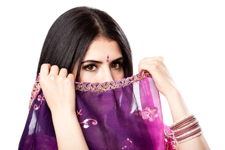 Beautiful Bengali Indian Hindu woman in colorful dress holding veil in front of face, isolated photo