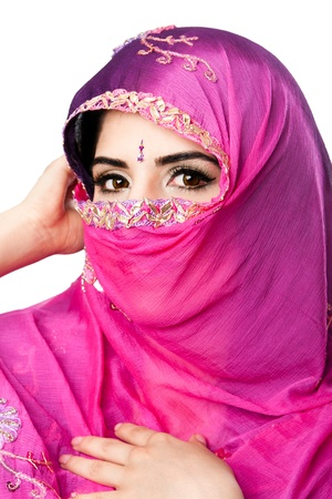 Beautiful Bengali Indian Hindu woman holding colorful headscarf veil in front of face, isolated