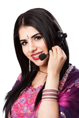 bengali: Beautiful Happy Indian Hindu Business Customer Service Representative at call center with headset microphone, isolated. Stock Photo