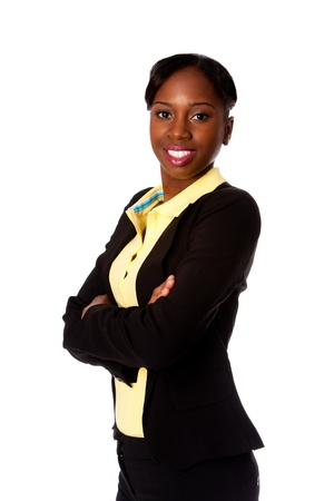 Beautiful happy smiling African business woman in suit and arms crossed, isolated.