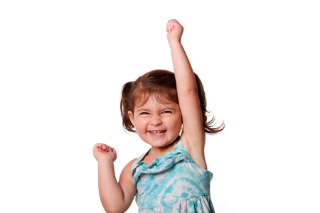 Cute beautiful funny happy little toddler girl celebrating with hand up in air, isolated. 版權商用圖片