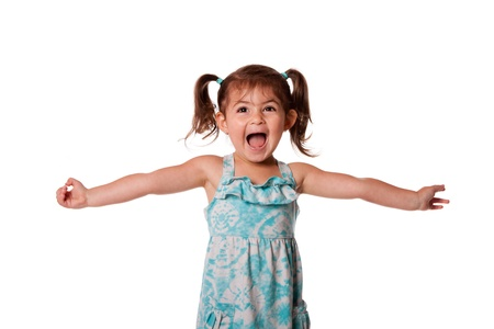 Cute beautiful funny ecstatic happy little toddler girl celebrating with open arms, isolated.