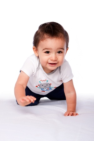Cute happy crawling baby toddler smiling, on white. Growing up concept.