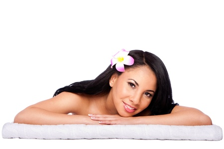 Beautiful happy female face, woman laying relaxing on white towel at holiday spa massage beauty treatment parlor photo