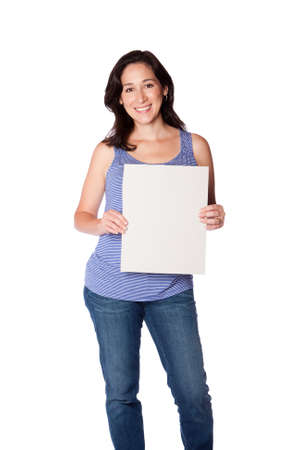 Happy smiling young woman holding whiteboard sign, isolated. photo