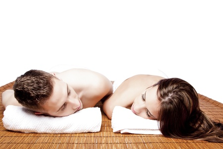 face massage: Couples holiday retreat at relaxing health spa for beauty treatment waiting for massage laying on bamboo. Stock Photo