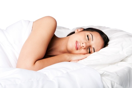 Woman happily beauty sleeping in white bed and dreaming, isolated.