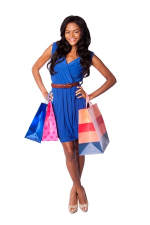 Beautiful happy smiling fashion woman shopping with bags, wearing blue dress and belt, on white