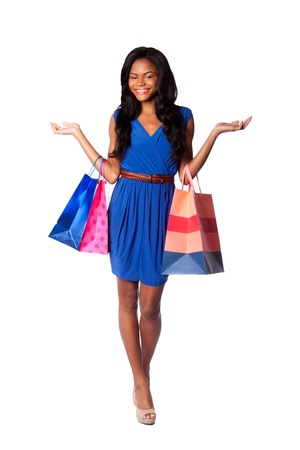 shopper: Beautiful happy smiling walking fashion consumer woman shopping with bags, wearing pumps, blue dress and belt, on white.