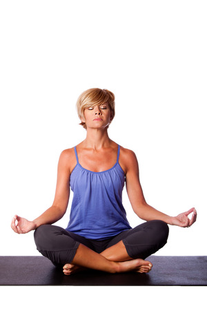 padmasana: Beautiful woman in Gentle Seated Lotus Position, Padmasana, in yoga meditation to align chakra, on white.