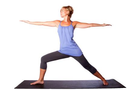 virabhadrasana: Warrior Two Virabhadrasana yoga pose extending arms by beautiful healthy woman, on white.