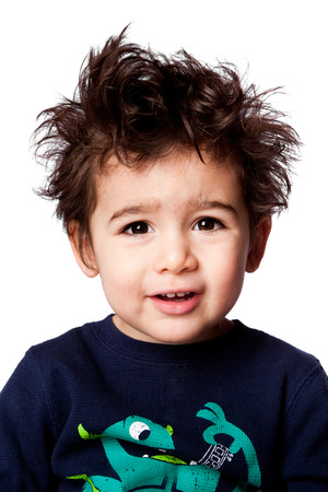 Cute adorable funny toddler boy facial expression with crazy hair, isolated. photo