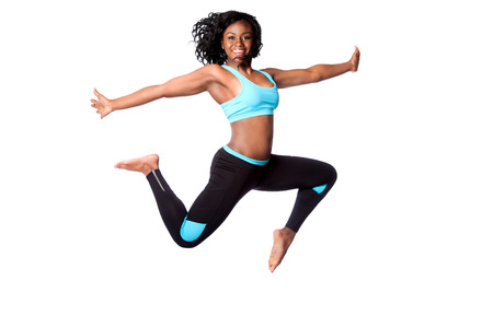 Beautiful happy energetic woman doing freedom sports jum with arms open, isolated.