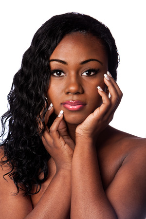 Beautiful face of African woman with hair extensions wig wavy hairstyle, isolated. Stock Photo