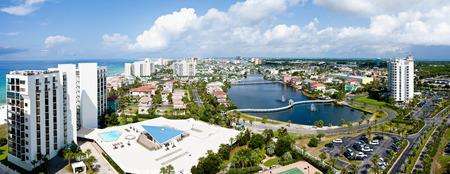 destin: Destin, FL, USA - July 24 2014: Panorama of touristic Destin on the Emerald coast of Florida.