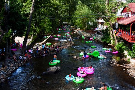 Helen, GA, USA - Aug. 31 2014: Tourist tubing the lazy river Chattahoochee in Alpine Helen, GA. Redakční