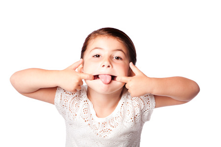 Cute girl making silly funny face, isolated. photo