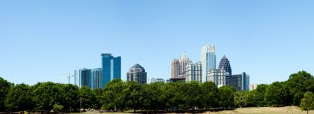 ga: Piedmont Park in Atlanta, GA with Skyline in the back on a sunny summer day.