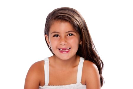 exchanging: Beautiful cute girl happy smiling missing exchanging teeth, on white. Stock Photo