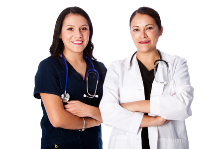 doctor female: Happy smiling attractive medical doctor and nurse team together, healthcare concept. Stock Photo