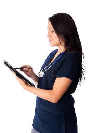 updating: Happy nurse updating writing in digital tablet patient chart medical records, on white.