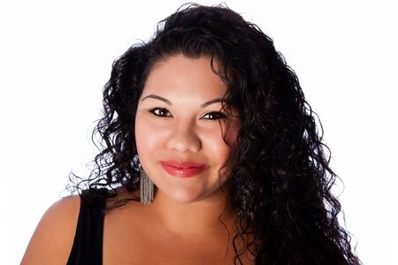 sized: Beautiful happy face of full plus sized latina with long curly hair, beauty skincare makeup concept. Stock Photo