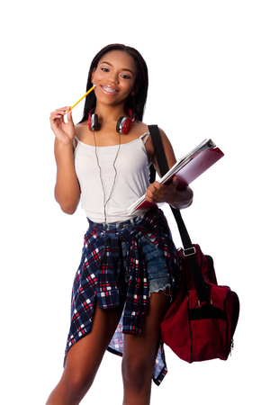 Beautiful happy smiling student standing thinking with pencil and notepad binders coming up with ideas, on white.