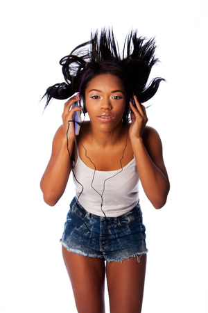 wild hair: Beautiful teenager jamming listening to music with wild hair, on white.