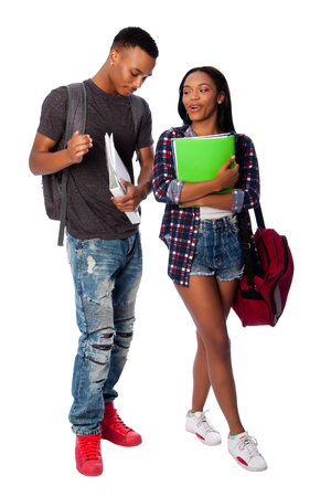 Happy smiling students standing together having fun talking joking carrying book bag backpack notepads, on white.