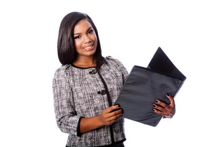 Beautiful happy smiling business woman holding portfolio binder, on white;