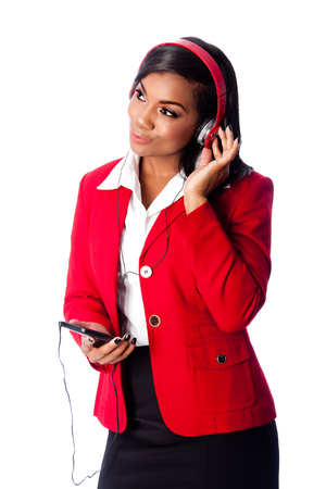 wireless telephone: Beautiful happy business woman listening to podcast or music on wireless mobile phone, on white.