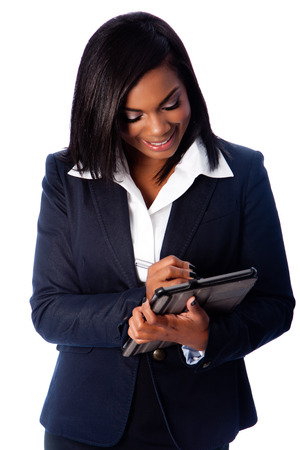 Beautiful happy smiling business woman writing on digital tablet taking notes, on white. Imagens
