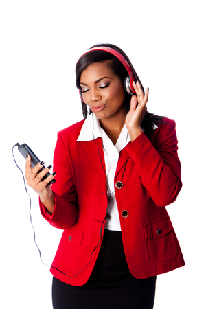 jamming: Beautiful happy business woman jamming listening to music on wireless mobile phone, on white. Stock Photo