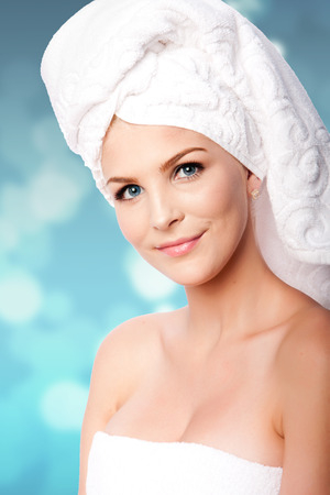 Beautiful clean happy woman with hair wrapped in towels after shower bath, hygiene concept.