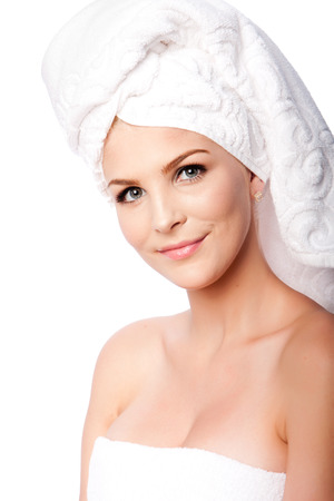 Beautiful clean happy woman with hair wrapped in towels after shower bath, hygiene concept, on white.